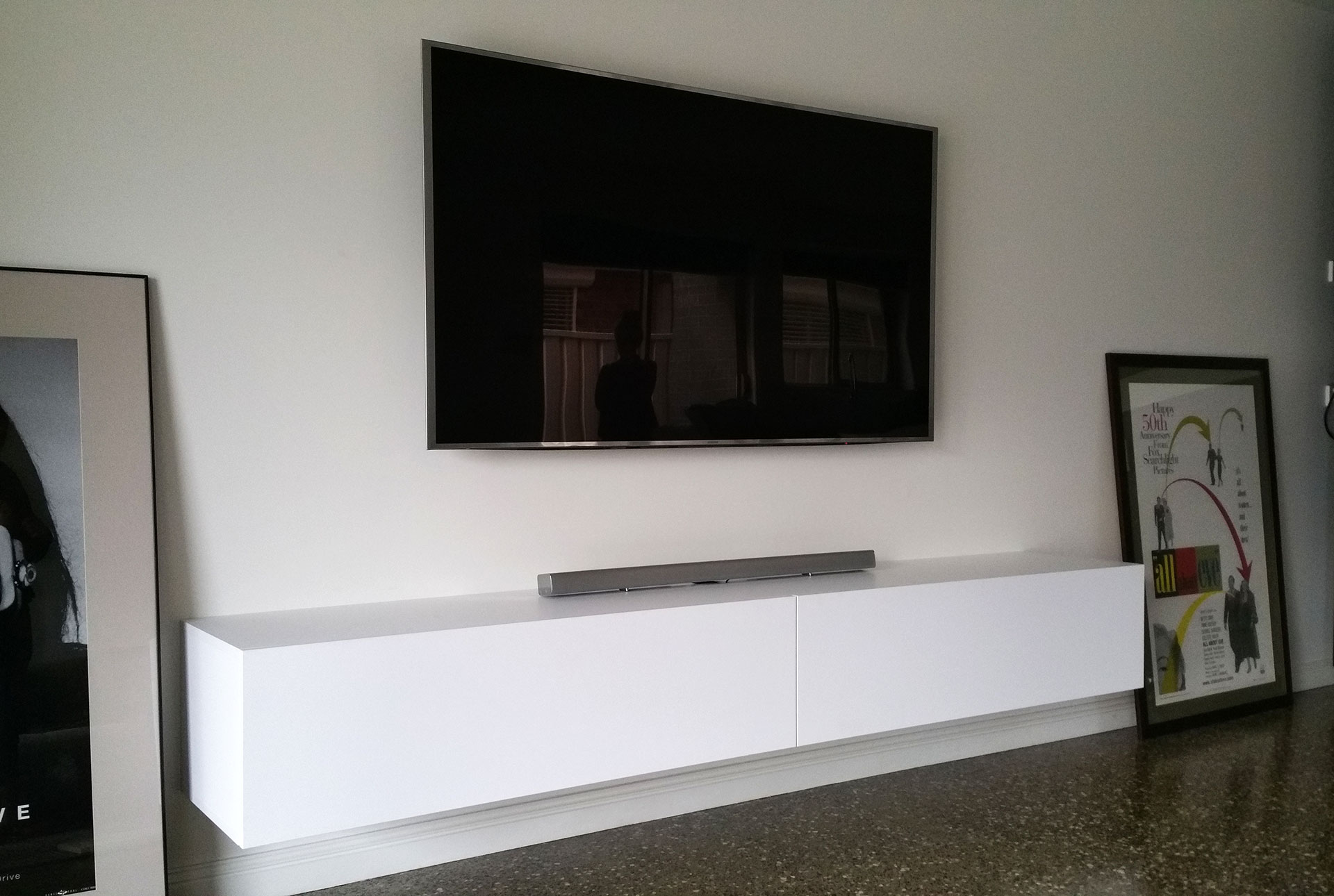 Modern floating tv entertainment units and tv cabinets tv for Wall mounted tv enclosure
